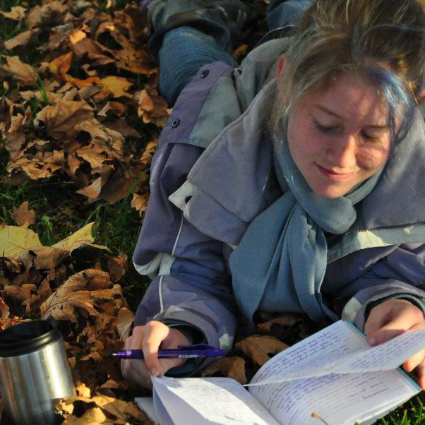 Amie writing while on a recent camping trip in the mountains