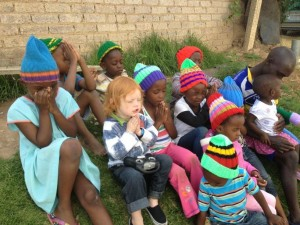 Cael praying with a group of children in the township where our gardener and friend Michael lives, November 2013